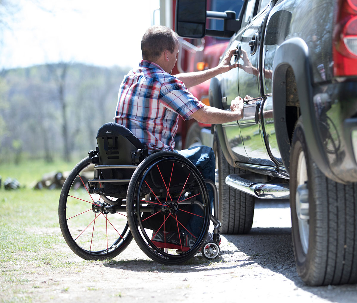 disabled-man-on-wheelchair-using-vehicle-picture-id1186772635