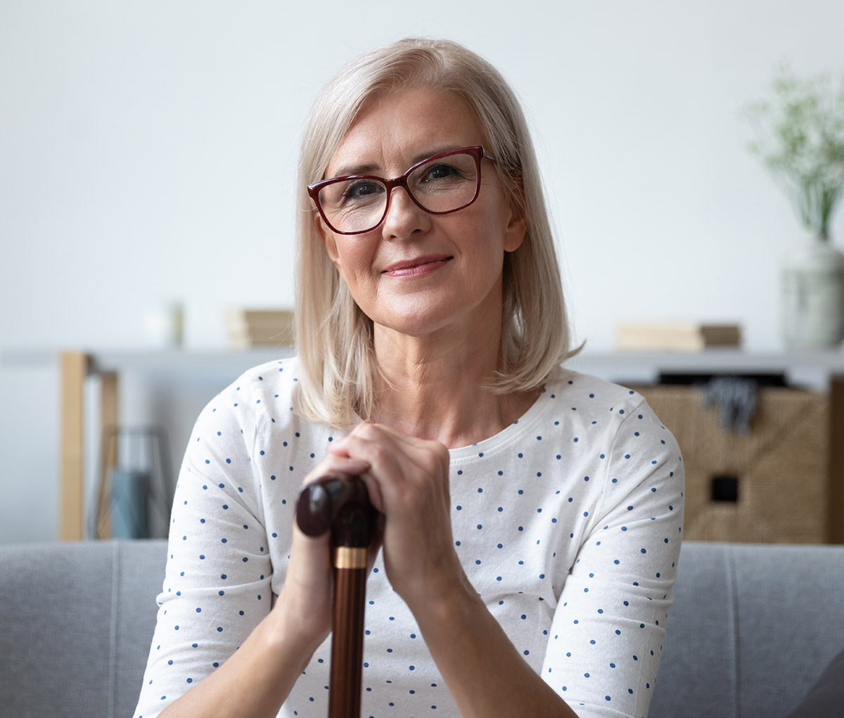 head-shot-portrait-beautiful-older-woman-in-glasses-with-cane-picture-id1180231087